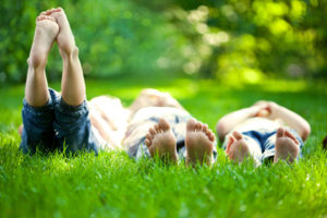 kids laying in the grass